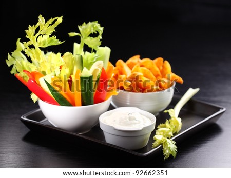 Raw vegetable and wedges with cream cheese dip - stock photo