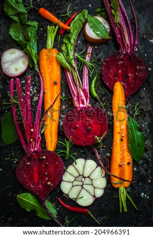 Raw vegetables for roasting, on a baking tray - stock photo