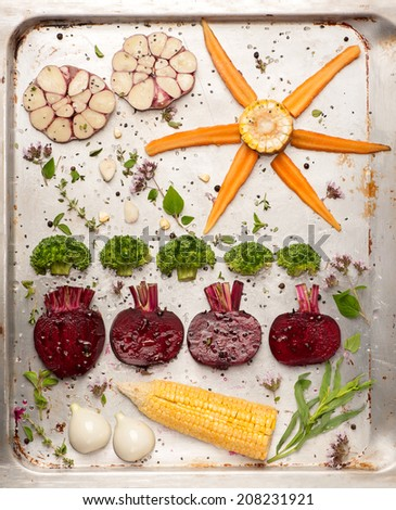 Raw vegetables for roasting on baking tray - stock photo