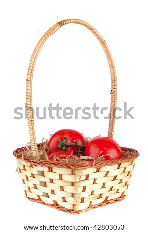 raw vegetables in basket over white background
