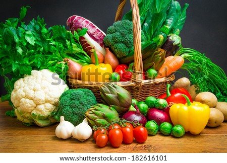 Raw vegetables in wicker basket - stock photo