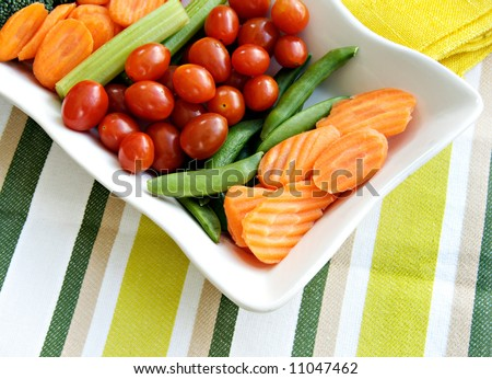 Raw vegetables to eat with dip including carrots, broccoli, and celery sticks. - stock photo