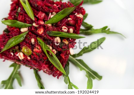 raw vegetarian salad with beetroot and greensprouting seed - stock photo