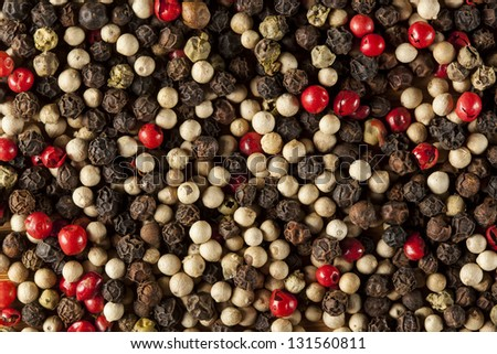 Raw Whole Four Peppercorn Blend against a background - stock photo
