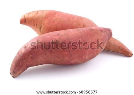 Raw, whole Sweet potatoes isolated on white background - stock photo
