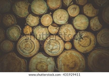 Raw Wood Logs Background. Lumber Works Photo Backdrop. - stock photo