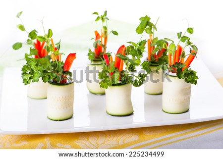 Raw Zucchini Roll-Ups with peppers,carrots,cheese and sprouts for holiday - stock photo