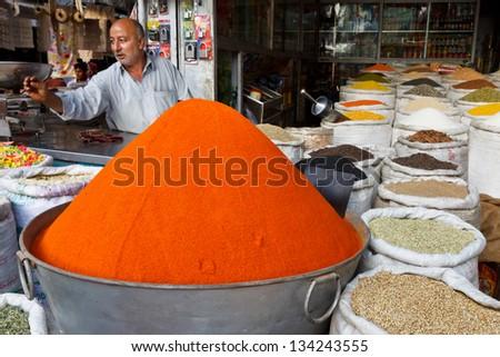 RAWALPINDI, PAKISTAN - JULY 16: Unidentified Pakistani man sells spices at Raja Bazaar on July 16, 2011 in Rawalpindi, Pakistan. Raja Bazaar is the main shopping area in Rawalpindi. - stock photo