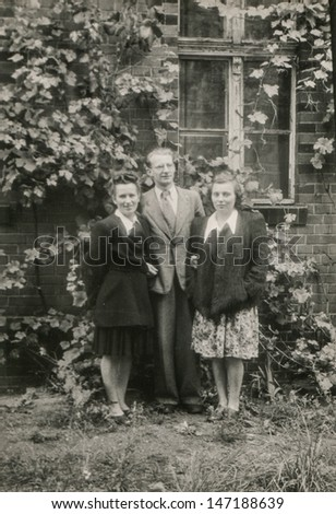 RAWICZ, POLAND, CIRCA FORTIES - Vintage photo of man and two young women, Rawicz, Poland, circa forties