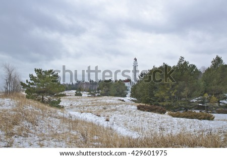 Rawleys Point Lighthouse sits in Point Beach State Forest in winter in Manitowoc County, Wisconsin.  - stock photo