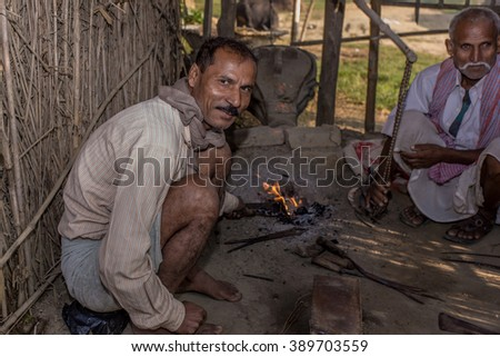 RAXAUL, INDIA - NOV 11: Unidentified Indian blacksmith working in his workshop on Nov 11, 2013 in Raxaul, Bihar, India. Bihar is one of the poorest states in India.