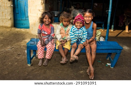 RAXAUL, INDIA - NOV 7: Unidentified Indian children on Nov 7, 2013 in Raxaul, Bihar state, India. Bihar is one of the poorest states in India. The per capita income is about 300 dollars. - stock photo