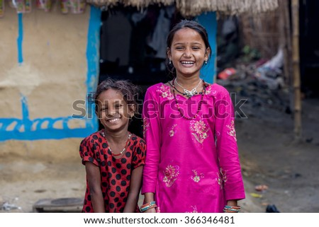 RAXAUL, INDIA - NOV 11: Unidentified Indian girls on Nov 11, 2013 in Raxaul, Bihar state, India. Bihar is one of the poorest states in India. The per capita income is about 300 dollars. - stock photo
