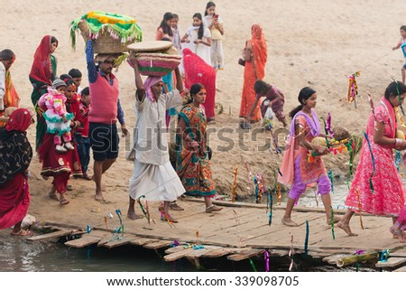 RAXAUL, INDIA - NOV 9: Unidentified Indian people celebrating Chhath on Nov 9, 2013 in Raxaul, Bihar state, India. Bihar is one of the poorest states in India.  - stock photo