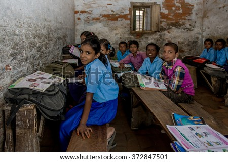 RAXAUL, INDIA - NOV 11: Unidentified Indian pupil in a local school on Nov 11, 2013 in Raxaul, Bihar, India. Bihar is one of the poorest states in India. - stock photo