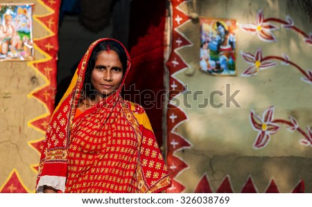 RAXAUL, INDIA - NOV 8: Unidentified Indian woman on Nov 8, 2013 in Raxaul, Bihar state, India. Bihar is one of the poorest states in India. The per capita income is about 300 dollars. - stock photo