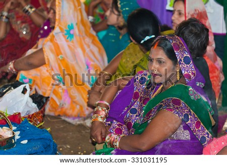 RAXAUL, INDIA - NOV 8: Unidentified Indian women at the Hindu Chhath festival offering prashad (prayer offerings) to the setting sun on Nov 8, 2013 in Raxaul, Bihar state, India.