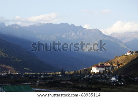 Ray of light falling upon Paro Dzong, Bhutan. - stock photo