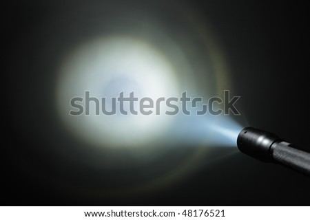 ray of pocket flashlight - stock photo