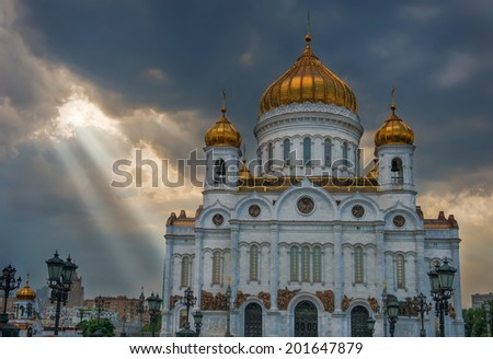 Ray of sunshine breaks through the clouds and shines on the Cathedral of Christ the Savior. Moscow. Russia. - stock photo