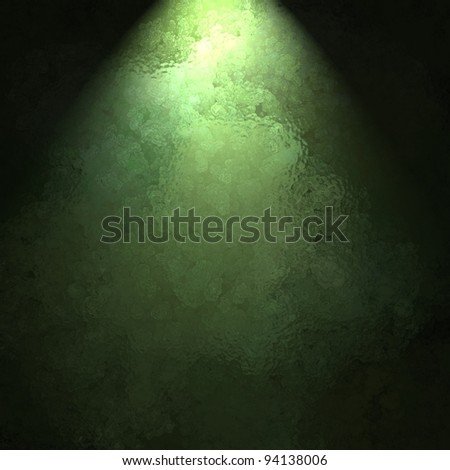 ray or beam of sunlight on marbled green background wall with black border and copy space for ad display or St. Patrick's day or Christmas announcement or invitation to party - stock photo