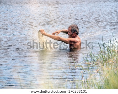 RAYONG, THAILAND - AUGUST 12, 2012: fisherman hunting fish in countryside river seine on August 12, 2012 in Rayong ,Thailand