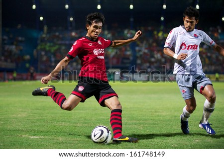 RAYONG,THAILAND-28 AUGUST:Teerasil Dangda #10 of Muangthong United in action during Thai FA Cup between Muangthong United and PTT Rayong F.C.at PTT Stadium on Aug 28,2013 in Thailand