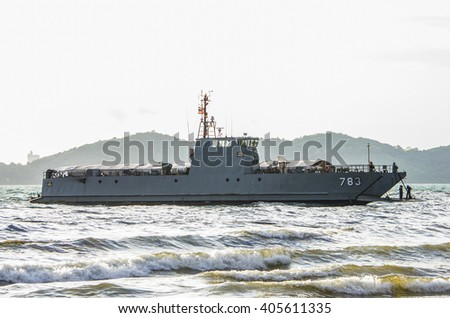 Rayong, Thailand - August 1, 2013: The Thai Navy ship is sailing close to Ao Prao beach, Koh Samet Island, Rayong province, Thailand during the big oil spill.