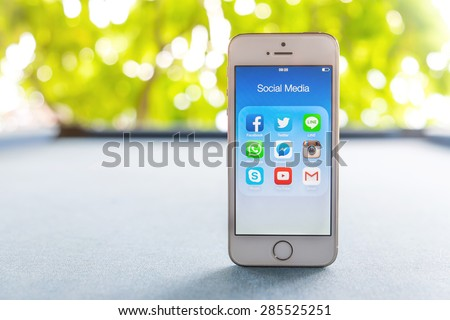 Rayong, THAILAND - June 03, 2015: All of popular social media icons on smartphone device screen on Apple iPhone 5s. - stock photo
