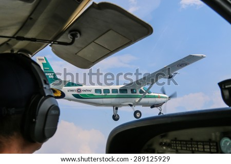 RAYONG , THAILAND- MAR 28 2015: Cessna 208 Caravan no.1918 of KASET , Bureau of Royal Rainmaking and Agricultural Aviation.Take off and landing at U-TAPAO Airport, Rayong - stock photo