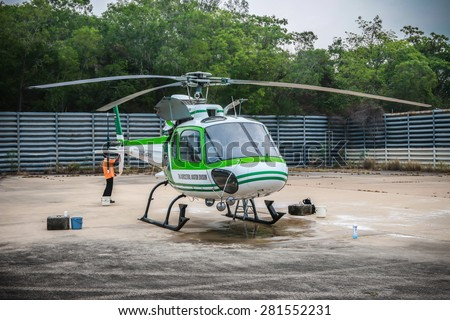 RAYONG , THAILAND- MAR 26 2015: Helicopter AS350 no.18301 of KASET , Bureau of Royal Rainmaking and Agricultural Aviation. U-TAPAO Airport, Rayong - stock photo