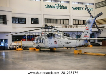 RAYONG , THAILAND- MAY 16, 2015: Sikorsky UH-60 Black Hawk helicopter No.3208 of royal thai navy standby in the hangar for maintenance. U-TAPAO Airport, Rayong - stock photo