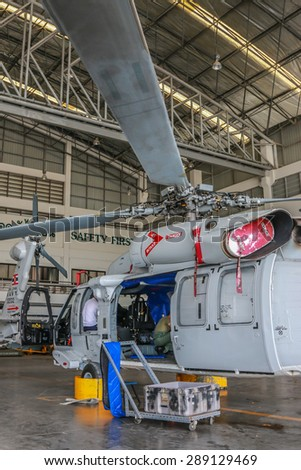 RAYONG , THAILAND- MAY 26, 2015: Sikorsky UH-60 Black Hawk helicopter No.3208 of royal thai navy standby in the hangar for maintenance. U-TAPAO Airport, Rayong - stock photo