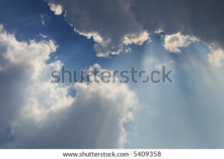 rays behind the clouds 3 - stock photo