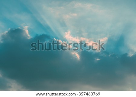 Rays of light shining through clouds, sunset