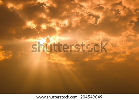 Rays of light shining through dark clouds for background