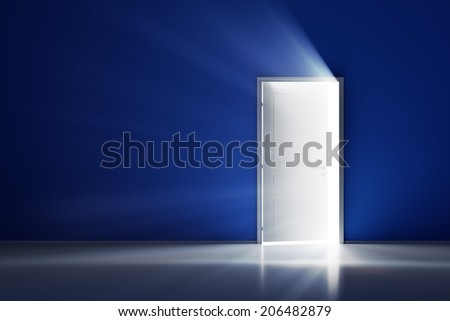 Rays of light through the open white door on blue wall - stock photo