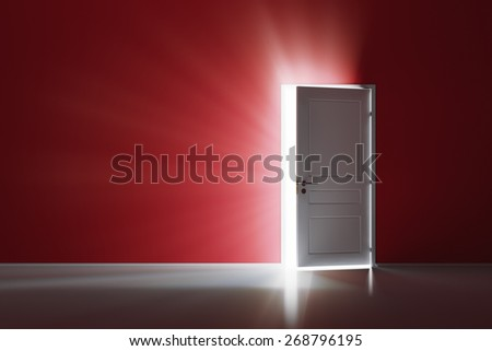 Rays of light through the open white door on red wall - stock photo