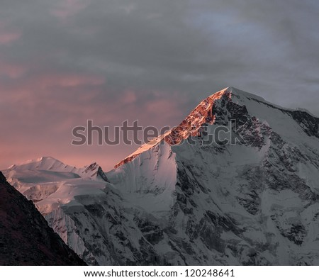 Rays of sunset on the tops of the mountains - Gokyo region, Nepal - stock photo