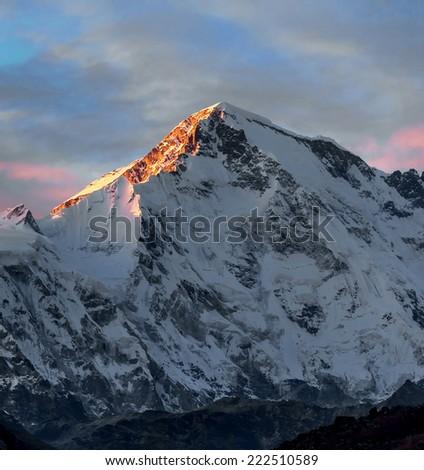 Rays of sunset on the tops of the mountains - Gokyo region, Nepal, Himalayas