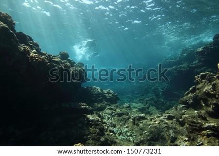 Rays of sunshine over a shallow reef on Lanai, Hawaii - stock photo