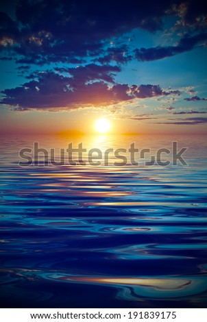 rays of the setting sun over the horizon. Vintage style - stock photo