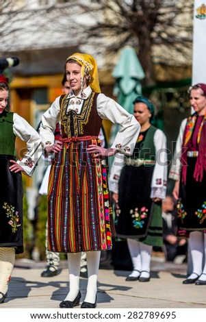 """RAZLOG, BULGARIA - APRIL 13, 2015: A beautiful female Bulgarian folklore singer during the traditional folklore festival """"1000 national costumes"""" - stock photo"""