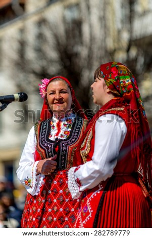 "RAZLOG, BULGARIA - APRIL 13, 2015: Two female Bulgarian folklore singers during the traditional folklore festival ""1000 national costumes"""
