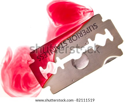 Razor blade with drop of blood in the water
