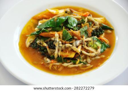 razor clam stir fry in dish white  - stock photo