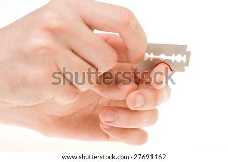 razor cuting finger - stock photo