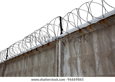 Razor Wire Above a Fence - stock photo