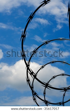 Razor wire keeps intruders at bay - stock photo