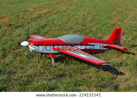 RC model airplane lands on the grass field  - stock photo